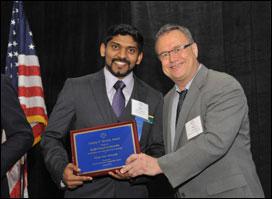 Picture of Ranjit Prasad Godavarthy accepting award